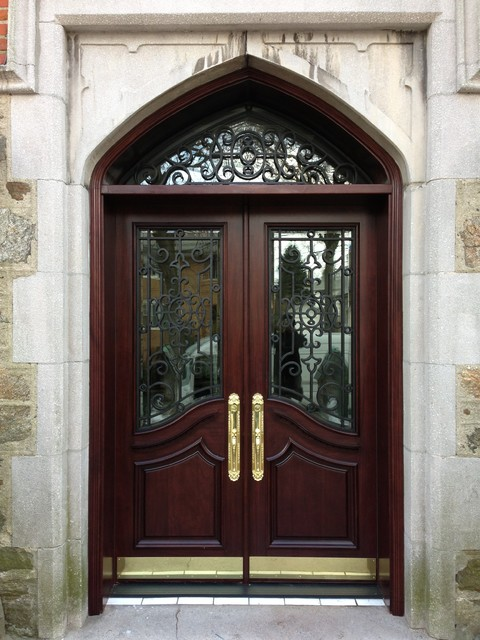 Wood With Wrought Iron Mediterranean Front Doors