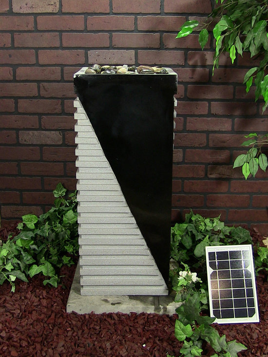 Outdoor Classics - Designer Tower Solar On Demand Fountain - Would look nice in a front door flower bed in front of a modern home.  The solar on demand feature is nice so you can charge up the fountain for use at night or cloudy days.