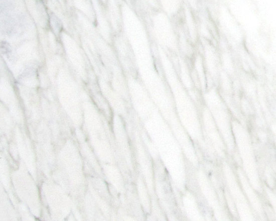 Marble Calacatta Michelangelo Slab - PENCIL THIN VEINS OF GREY WITH HINTS OF GOLD CREATE MOTION ACROSS A CREAMY WHITE BACKGROUND.