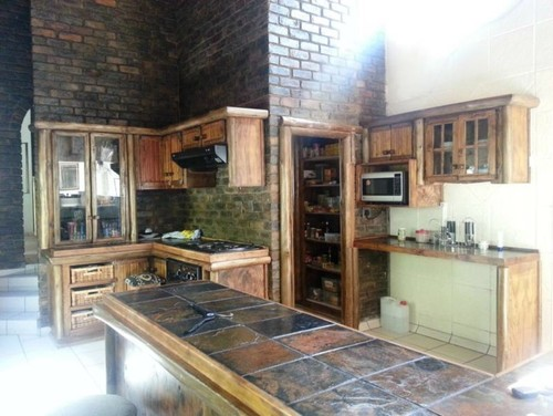 Dark face brick kitchen to plaster or not for Face brick home designs