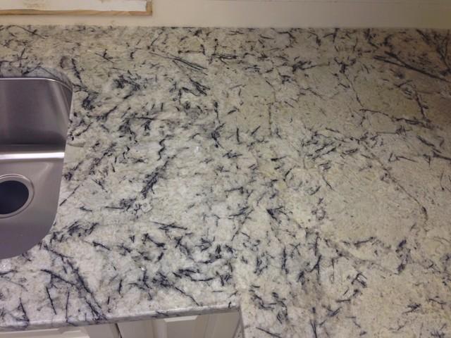 The perfect seam craftsman kitchen countertops for Seamless quartz countertops