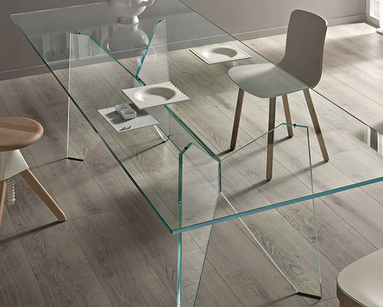 Modern Living - Modern All Glass Dining Table. Table with extra clear glass surface resting on a luxurious wing structure. The central beam of varying length is held by two extremely optimized legs inspired by the '50s and the formal and structural experimentation of Jean Prouvé.