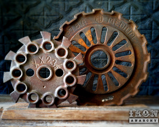 """Antique Industrial Gear Decor - Fantastic set of old gears of thick cast iron in hardcore industrial designs. Engraved text to make them even more intriguing! Reclaimed lumber display stand. Gears measure 5 1/2"""" and 7 5/8"""" in diameter."""