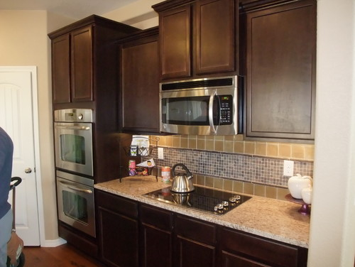 dark wood cabinets but I feel like i need to lighten up my kitchen