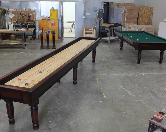 Michigan Made Custom Pool Tables - Add a McClure custom made shuffle board to your basement today! Each of our game tables are made with one hundred percent North American maple wood and to your needs and wants.  Not only will your shuffleboard table be a main focal point of your basement but also bring together your family and friends for hours of entertainment and fun and friendly competition.