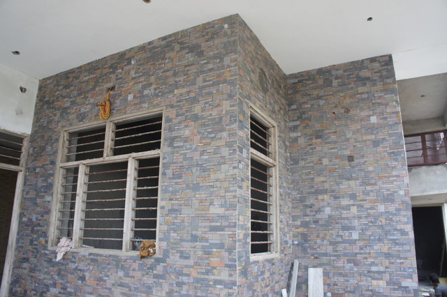 House exterior design using indian natural stone for Exterior wall tiles design india