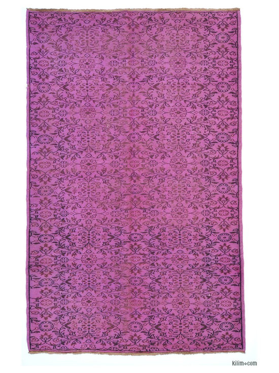 Over-dyed Anatolian Vintage Rug - This piece is an Over-dyed Anatolian Vintage Rug created by first neutralizing the colors and then over-dying with lilac to achieve a contemporary effect and bring old hand-made rugs back to life. The result is almost like an abstract painting.