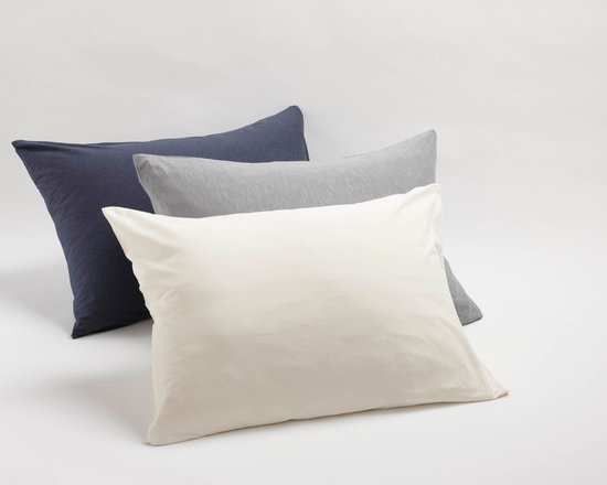 Organic Jersey Pillowcases - The soft jersey bedding captures everything you love about your favorite vintage t-shirt. Comfortable and easy to care for, the knit is made of organic cotton with coconut shell button closure. Sourced and woven in India.