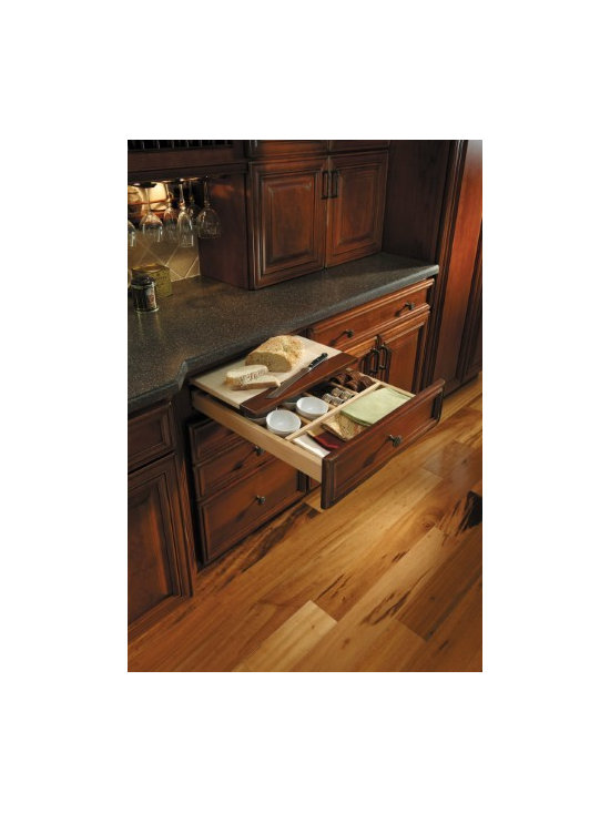 Getting Organized with Fieldstone Cabinetry - Utensil Storage Drawer, being used for napkin rings & small bowls, with pull out cutting board...perfect for your butlers pantry.