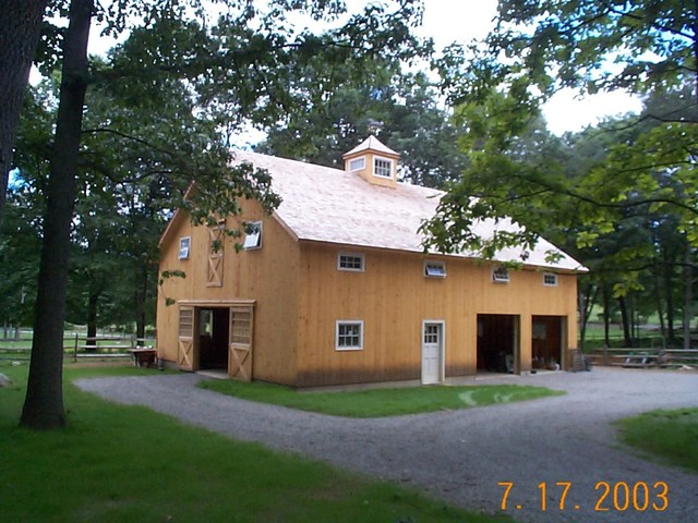 Horse barn garage caretakers apartment rustic for Pole barns with apartments