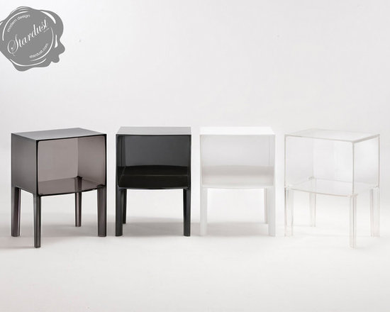 Nightstands and Bedside Tables: Kartell Small Ghostbuster Table - The complete line up of the Kartell small Ghostbuster tables from Stardust.com.  Designed by Phillippe Starck and Eugeni Quitllet, the Ghost Buster is the next generation of iconic ghost designs. This small table will look at home in any corner of the house, next to the bed, sofa or even in the bathroom. Available in completely transparent, colored or matte versions it is made of plastic and will complement any interior.  Nice when used as a bedside table, nightstand, living room side table or as a small bathroom organizer for towels and such.  Available from: http://www.stardust.com/smallghostbuster.html