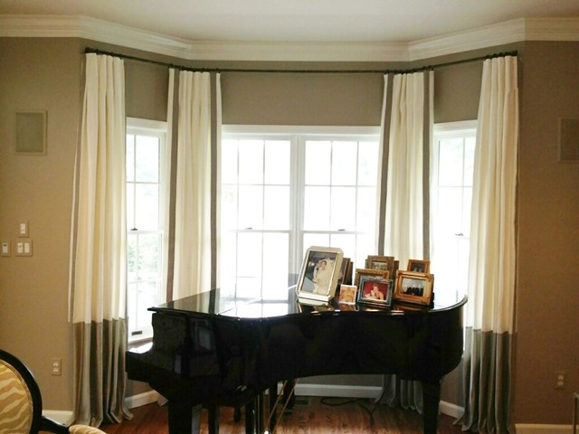 Color block curtains with trim on the edge for a bay