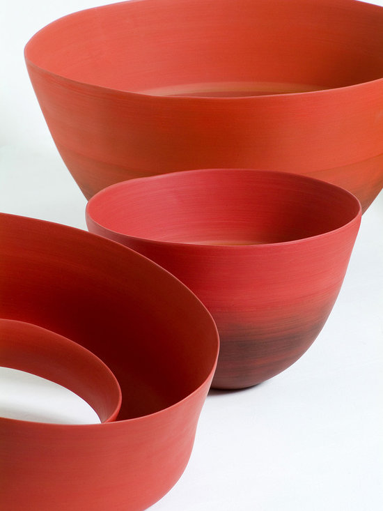 Rina Menardi bowls in poppy - Rina Menardi is a world renown ceramic artist based in Italy. Her stoneware collection is completely handmade and is characterized by simple lines, organic colours and shapes inspired by nature. The surface and finishing is realized using ancient techniques that date back to the origins of ceramics.