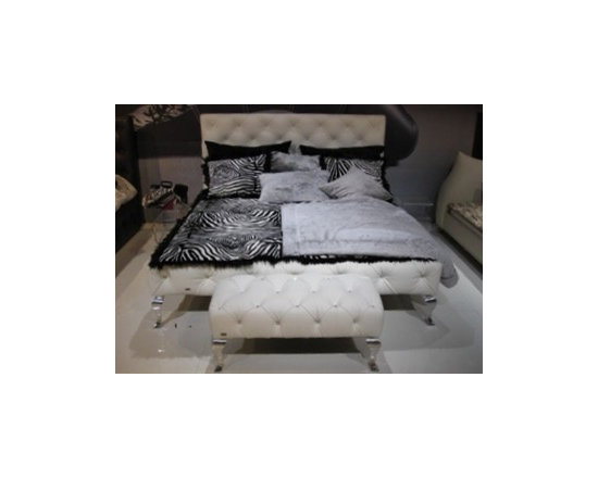 Frampton Modern Leather Bed Frame with Crystal Accents - Luxurious hand-tufted leather upholstery accented with crystals set into the tufts. Exquisitely designed ornate chrome legs represent perfection in design in the Frampton Modern Leather Bed Frame.