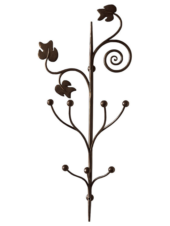 Caporali - Pruno Wall Hook by Caporali - Tuscany, Italy - Hand forged in the Caporali workshop (Santa Mama, Tuscany, Italy), this beautifully designed wall mounted Pruno wall hook is made by hand in Italy by skilled artisans. Since 1885, the Caporali family has been forging iron in Tuscany using the same methods passed down through four generations. Each piece is a work of art yet perfectly functional. The Pruno blends functionality incorporating seven hanging bars with the grape leaf design. As an addition to your home entrance, it makes a subtle statement about your appreciation and respect for the highest quality and design in home furnishings.