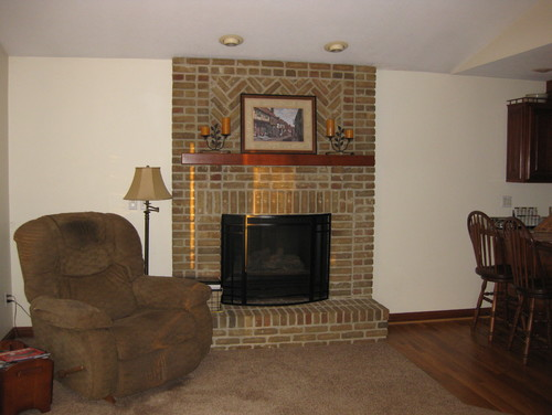 No windows on sides of fireplace awkward walls to for Fireplace with windows on each side