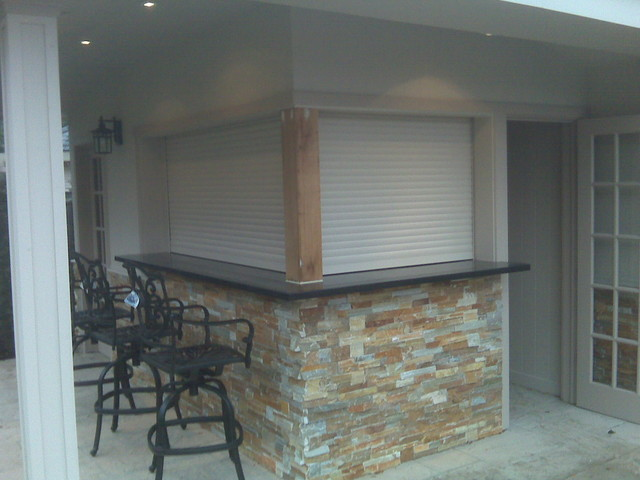 Shutters Enclosing Outdoor Kitchen And Bar Modern