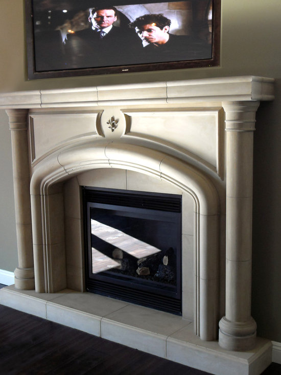 Fireplace mantels - Cast stone fireplace mantel and over mantel design in smooth and travertine finishes.  Custom floor to ceiling mantel designs.