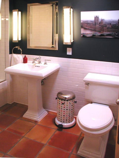 Showing the second picture of the bathroom     kind of cool with the more  contemporary vibe. terra cotta color tile     BATHROOM floor