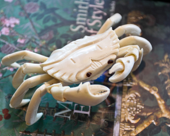 Kiawah Family Home - a sweet little crab sits on a coffee table book....an ode to the local wildlife