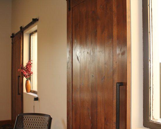 Lifesong for Orphans - Barn door hardware is used in this project. If there is a storm the doors or shutters can be closed over the windows creating a shelter