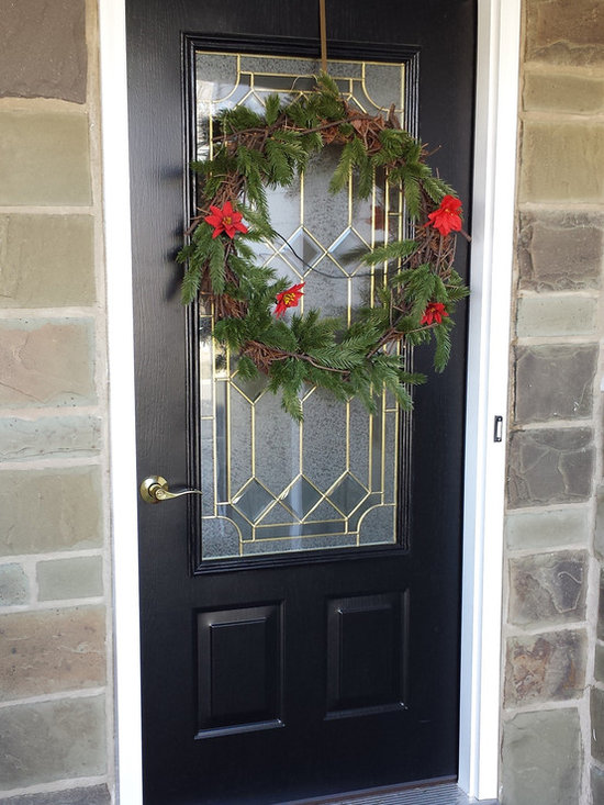 Doors - This lovely door is welcoming and secure and provides light to the homeowner's entryway.
