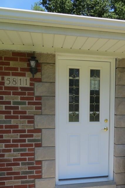 Entry Door Before New Storm Door traditional-windows-and-doors