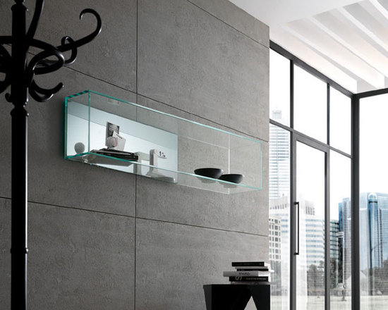 Brama Glass Shelf - One idea, three shapes, numerous uses: the glass shelf series Brama 1, 2 and 3, designed by Matteo Ragni for Tonelli Design, are characterized by versatility and functionality, that makes them fit for the different house areas. Series of wall shelves in glass and mirror. Available in clear or extra clear glass.