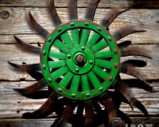 """Antique Industrial Gear Decor - Stunning old wheel in an aggressive industrial style! Wall bracket with integrated bearings allow it to spin in place, creating a dazzling effect with light and shadow! 19"""" diameter."""