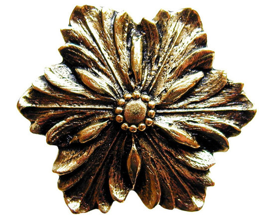 """Inviting Home - Opulent Flower Knob (bright brass) - Hand-cast Opulent Flower Knob in bright brass finish; 1-3/8"""" diameter Product Specification: Made in the USA. Fine-art foundry hand-pours and hand finished hardware knobs and pulls using Old World methods. Lifetime guaranteed against flaws in craftsmanship. Exceptional clarity of details and depth of relief. All knobs and pulls are hand cast from solid fine pewter or solid bronze. The term antique refers to special methods of treating metal so there is contrast between relief and recessed areas. Knobs and Pulls are lacquered to protect the finish. Alternate finished are available. Detailed Description: The Opulent Scroll pulls add an amazing focus to any drawers or cabinets - it will make them look regal and majestic. The absolute perfect place for these pulls to be used is in the dining room on your china closet. They are great pulls to use if you are trying to punch up an antique piece of furniture or cabinet. You should consider using the Opulent Scroll pulls in combination with the Opulent Flower knobs or wood knobs with flower."""