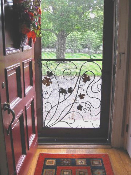 Functional Metal Art, Wrought iron - Earth Eagle Forge created a unique screen door guard.  Have one designed for your screen door.