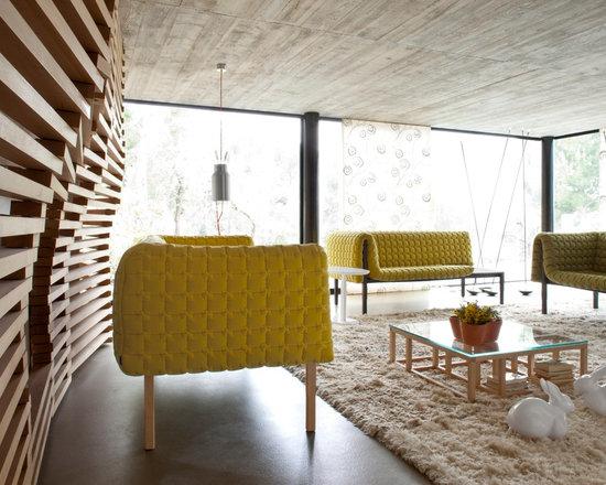 Ruche - Ligne Roset - Ruche sofas, Lantern suspended lamp, Antigone low table, Pan Pan decorative rabbit.