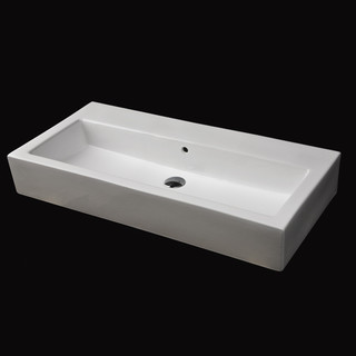 long bathroom sink with two faucets