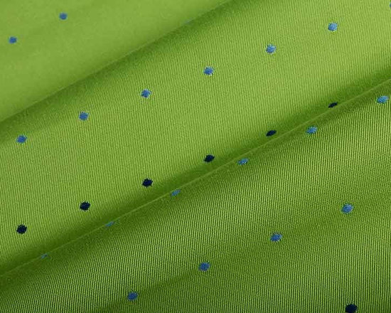 Outdoor Spot Upholstery Fabric in Lime Green - Outdoor Spot Upholstery Fabric in Lime Green is a polka-dot patterned high traffic upholstery fabric perfect for indoor or outdoor use. Bright and cheery, this lime green base has rows of blue dots that are sure to put you in a happy mood. Made in the USA with 100% High UV Polyester, this fabric has a width of 54″ and a vertical repeat of 6 3/4″ and horizontal repeat of 1 3/4″.