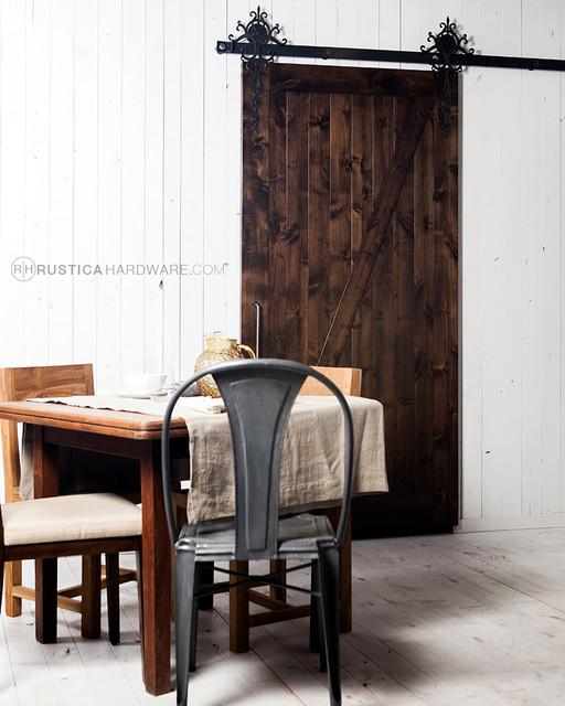 Royal barn door hardware mediterranean dining room for Barn door dining room