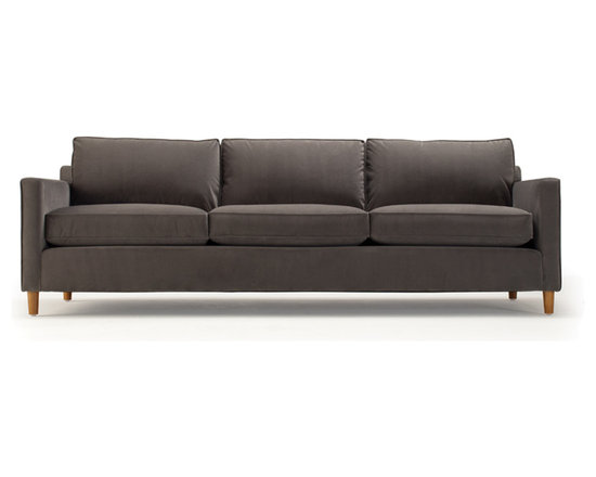 Martin Sofa - Long, low, and streamlined, with clean minimalism, the Martin sofa is a tribute to Mid-century modern design. Tall, round recessed legs enhance the modern feel. Martin's loose seat and back cushions offer exceptional comfort while keeping the look sleek.