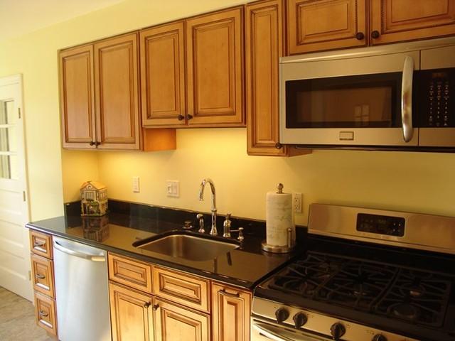 light brown kitchen cabinets sandstone rope door