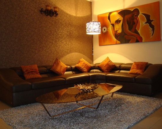 RESIDENCE 1 - BRANDED ITALIAN LEATHER SOFA AND CUSTOM MADE METAL / GLASS OVAL CENTRE TABLE.