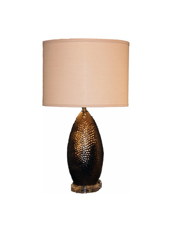 St James Lamp Gold Lamp - This gorgeous hammered gold and linen lamp is like modern, sexy jewelry for your home. The organic base is somehow luxe and understated all at once while the beige linen shade is the perfectly unassuming accent. Try using this to complement a warm color palette in a contemporary space.
