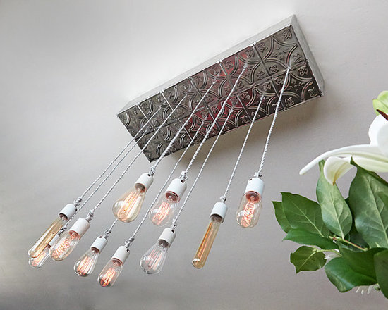 Unique Applications with Tin Ceiling Tiles - A DIY chandelier made out of tin tiles is a visually interesting addition to your home.