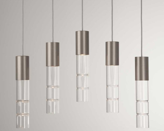 Hammerton - Bamboo Linear Suspension - Bamboo Linear Suspension is available in a Metallic Beige Silver or Flat Bronze finish with Clear glass. Available in a 3-light and 5-light version. The Bamboo collection pairs sparking smooth columns of fire polished glass with beautifully finished metalwork to achieve a sleek, sophisticated contemporary aesthetic. American artisans carefully hand-form and craft each piece of bamboo glass to achieve its distinctive luminous quality. Our broad selection of Bamboo fixture styles lets you showcase this remarkable look in surprising ways throughout your home. 35 watt 120 volt MR16 medium base halogen lamps are required but not included. UL listed for dry locations. Dimensions: 3-Light: 19 inch width x 14.2 inch shade height x 19 inch minimum to 62 inch maximum overall length. 5-Light: 31 inch width x 14.2 inch shade height x 19 inch minimum to 56 inch maximum overall length.
