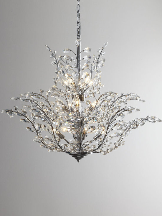 Lighting - Glittering crystals flow upwards on this charming chandelier. Imported.