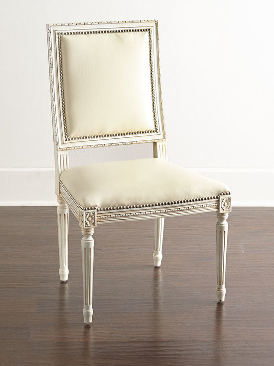 "Massoud - Ingram Leather Dining Chair C1 - IVORY - MassoudIngram Leather Dining Chair C1DetailsEXCLUSIVELY OURS.Handcrafted chair.Mahogany frame with Bisque (cream) finish.Leather upholstery.Houston (silver) nails.23""W x 23""D x 39""T. Seat 18""W x 17""D x 19""T.Made in the USA of imported materials.Boxed weight approximately 50 lbs. Please note that this item may require additional shipping charges.Designer About Massoud:Company president Chuck Massoud's father combined his entrepreneurial spirit with loans from three friends to start Massoud Furniture in 1962. Since then the Massoud family has been crafting its distinctive brand of custom seating. Massoud is credited for putting pitch in their wing chairs leaning them back slightly makes them so much more comfortable than the classic wing chair with a straight back. All Massoud furniture features kiln-dried hardwood frames and the finest leathers and fabrics available. They also employ multiple support rails reinforced corner blocks mortise-and-tenon joinery and suspended coil systems for comfort and quality craftsmanship that lasts a lifetime."