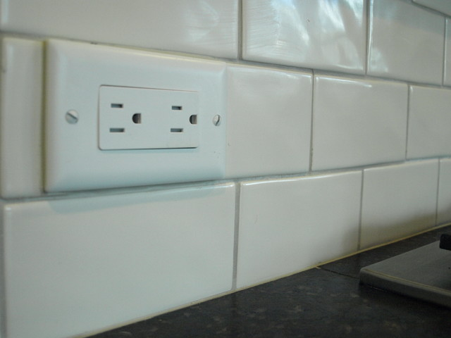 Flipping The Outlets Helps Them Disappear In The Subway Tile Backsplash