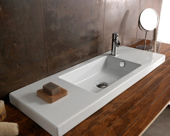 "Tecla - Wide Modern Ceramic Wall Mounted, Vessel, or Built-In Sink by Tecla - Modern style wide rectangular white ceramic sink with overflow. Sleek bathroom sink has left and right side counter space and is available with a single faucet hole (as shown) or no hole. Made in Italy by Tecla. Can be installed and used as a wall mounted, vessel, or vanity sink. Sink dimensions: 39.37"" (width), 13.78"" (depth)"