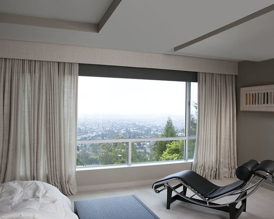 Bedroom Curtains - Blackout roller shades with Jim Thompson silk curtains warm up this Berkeley Hills modern bedroom.