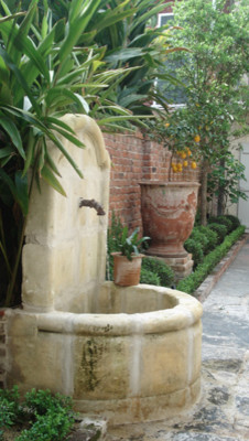 Wall Fountains out of Antique Limestone mediterranean-outdoor-fountains-and-ponds