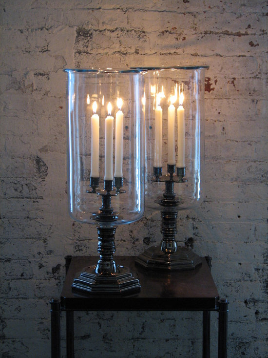 Trefoil Hurricane - Influenced by the grand Louis XIV style, the Trefoil Hurricane is purposefully large-scale and designed for use with three candles, the base and metal work is plated in black nickel and the shade is hand-blown with a rolled lip at the top.