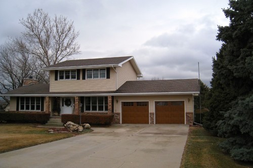 Husband wants more garage shocking i know for Building onto your existing home