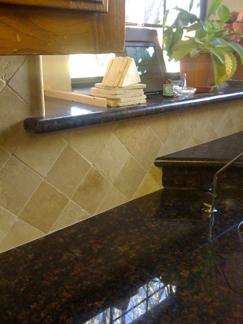beige travertine diagonal backsplash traditional kitchen